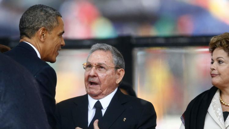President Obama greets Cuban President Castro at the memorial