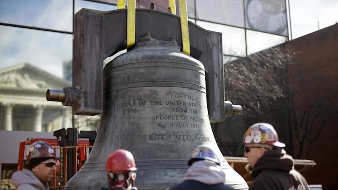 Workmen prepare the Bicentennial Bell before lifted it to a shipping container, Thursday, Jan. 31, 2013, in Philadelphia. The bell made in the same British foundry as its twin of the iconic Liberty Bell was a 1976 Bicentennial gift from from England and was presented by Queen Elizabeth II to the city.  The bell tower and its accompanying building, constructed for the 1976 Bicentennial, are being demolished to make way for a Revolutionary War museum.  (AP Photo/Matt Rourke)
