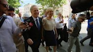 Premier Jean Charest walks to the lieutenant-governor's office in Quebec City this morning.