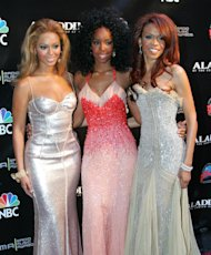 FILE - This Oct. 25, 2004 file photo shows members of Destiny&#39;s Child, from left, Beyonce Knowles, Kelly Rowland and Michelle Williams at the Radio Music Awards at the Aladdin Theater for the Performing Arts in Las Vegas. The R&B trio announced Thursday, Jan. 10, 2013, that they will release a new track called Nuclear. The song is the group&#39;s first new offering since 2004. (AP Photo/Eric Jamison, file)
