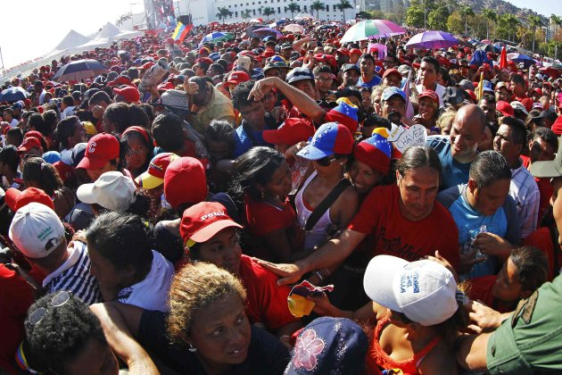 Supporters of Venezuela's late President Hugo Chavez wait to view his body in state at the Military Academy in Caracas