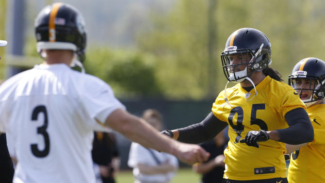 Pittsburgh Steelers first round draft choice, linebacker Jarvis Jones, right, out of Georgia, and fourth round draft pick quarterback Landry Jones out of Oklahoma, stretch  during NFL football rookie minicamp on Friday, May 3, 2013 in Pittsburgh. (AP Photo/Keith Srakocic)