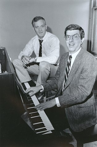 "FILE - This Sept. 9, 1986 file photo shows composer Marvin Hamlisch, right, at the piano with lyricist Howard Ashman in New York. Hamlisch, a conductor and award-winning composer best known for the torch song ""The Way We Were,"" died Monday, Aug. 6, 2012 in Los Angeles. He was 68. (AP Photo/Nancy Kaye, file)"