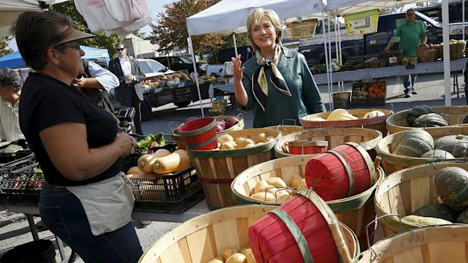 U.S. Democratic presidential candidate Hillary Clinton shops at a farmer's market in Davenport