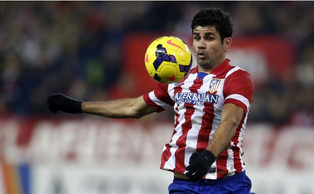 Atletico Madrid's Costa controls the ball during their Spanish first division soccer match against Barcelona in Madrid