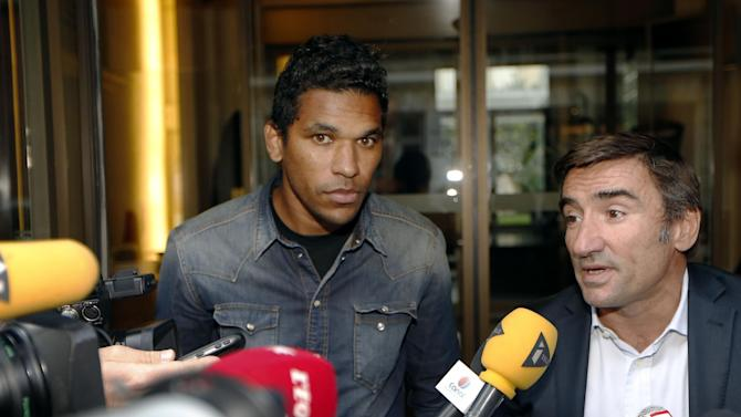 Bastia's Brazilian forward Brandao (L) and his lawyer Olivier Martin speak to the press after a hearing at the French professional fooball league on August 21, 2014, in Paris