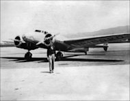 American aviator Amelia Earhart in front of her plane. Earhart was flying with navigator Fred Noonan during the final stage of an ambitious round-the-world flight along the equator at the time that her plane disappeared in 1937