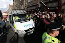 Nigel Farage rescued from &#39;anti-racist&#39; protest