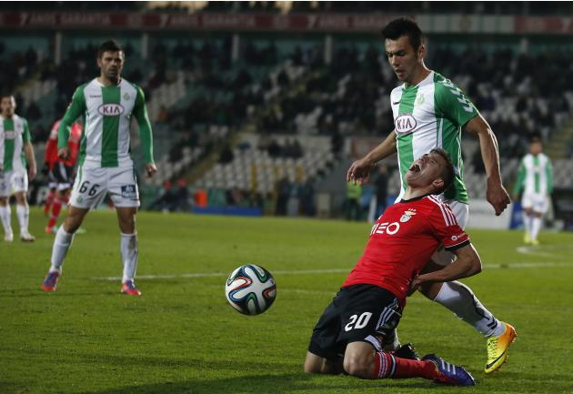 Benfica's Gaitan is tackled by Vitoria Setubal's Pedroso during their Portuguese Premier League soccer match in Setubal