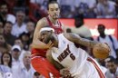 Heat&#039;s James drives past Bulls&#039; Joakim Noah during the fourth quarter in Game 5 of their NBA Eastern Conference semi-final basketball playoff in Miam