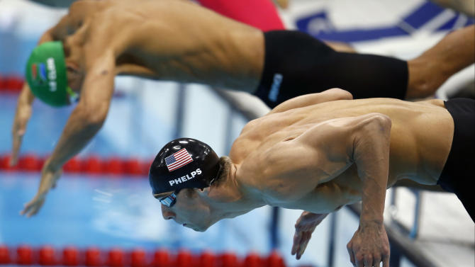 South Africa's Chad le Clos, top, and United States' Michael Phelps take the start in the men's 100-meter butterfly swimming final at the Aquatics Centre in the Olympic Park during the 2012 Summer Olympics, London, Friday, Aug. 3, 2012.  (AP Photo/Jae C. Hong)