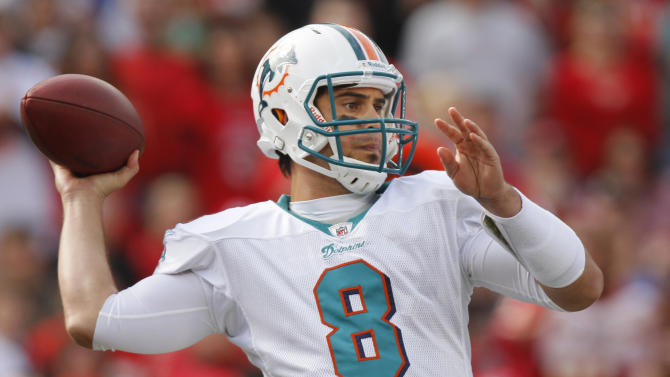 Miami Dolphins quarterback Matt Moore (8) drops back to pass during the first half of an NFL football game against the Kansas City Chiefs in Kansas City, Mo., on Sunday, Nov. 6, 2011. (AP Photo/Ed Zurga)