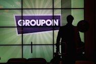 Groupon shares surged Friday as market players reacted to chatter about a possible takeover for the troubled online deals company
