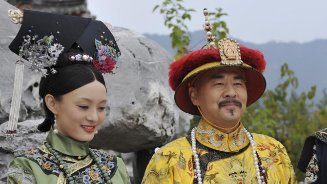 """This undated photo released by Videoland Cable Network Taiwan shows Chinese actress Sun Li and actor Chen Jian Bin in costumes on set of the TV series """"The Legend of Zhen Huan"""" in mainland China. Set in the imperial palace of the Qing dynasty in the 17th century """"The Legend of Zhen Huan"""" is a TV drama series written by a 28-year-old Chinese online fiction writer that has captivated viewers in Taiwan, but its emphasis on the dark side of human nature has made it less popular with cultural authorities in China. (AP Photo/Videoland Cable Network) EDITORIAL USE ONLY"""
