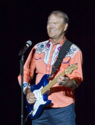In this photo taken Thursday, Sept. 6, 2012, singer Glen Campbell performs during his Goodbye Tour in Little Rock, Ark. (AP Photo/Danny Johnston)
