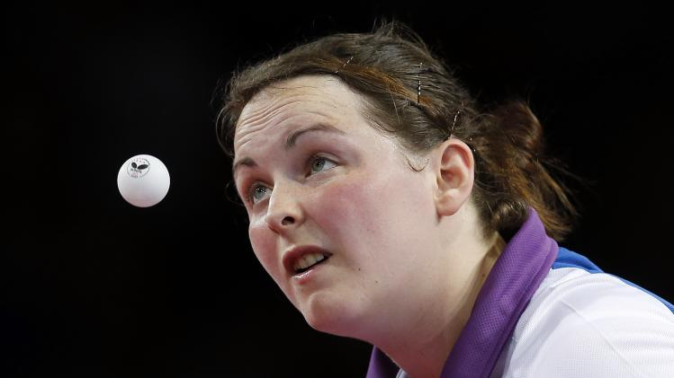 Scotland's Whitaker serves the ball during her match against Guyana's Lowe in the women's table tennis preliminary round at the 2014 Commonwealth Games in Glasgow