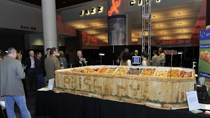 "Pillsbury unveiled its Ultimate Snackadium at the Taste of the NFL's ""Party with a Purpose"" to support the fight against hunger on Saturday, Feb. 2, 2013 in New Orleans. (G. Newman Lowrance/AP Images for Pillsbury)"