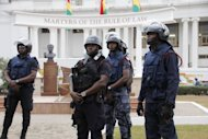Policemen stand guard in front of Ghana's Supreme Court after it upheld President John Dramani Mahama's win in elections last year, dismissing the opposition's case alleging voter fraud in a test for one of Africa's most stable democracies, on August 29, 2013 in Accra