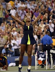 Serena Williams of the US celebrates defeating Victoria Azarenka of Belarus 6-2, 2-6, 7-5 in the 2012 US Open women's singles final at the USTA Billie Jean King National Tennis Center in New York
