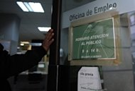 A man enters a government employment office in Sevilla. Spain&#39;s jobless rate surged to a record 24.4 percent at the end of March as 5.6 million people searched for work in a recession-bound, deficit-plagued economy, data showed Friday