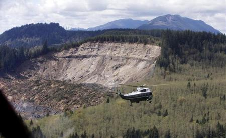 Marine One carrying U.S. President Barack Obama tours the mud slide damage in Oso