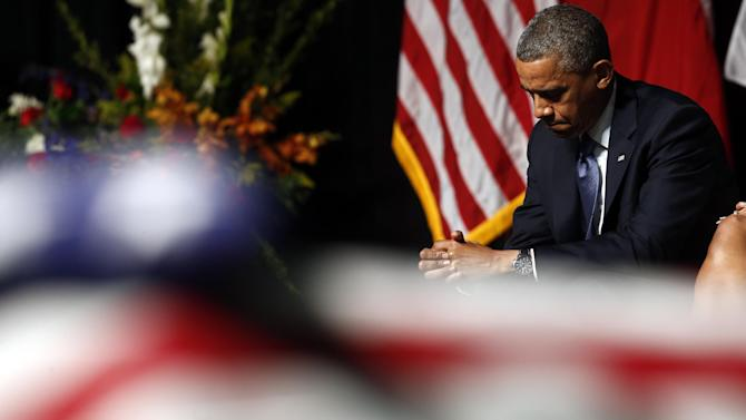 President Barack Obama attends the memorial for firefighters killed at the fertilizer plant explosion in West, Texas, at Baylor University in Waco, Texas, Thursday, April 25, 2013. (AP Photo/Charles Dharapak)