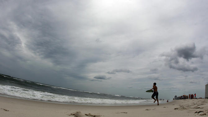 A boy plays in the surf in waves ahead of Tropical Storm Isaac in Orange Beach, Ala., Monday, Aug. 27, 2012. (AP Photo/John Bazemore)