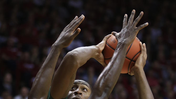 Jacksonville's Glenn Powell puts up a shot against Indiana's Victor Oladipo during the first half of an NCAA college basketball game Friday, Dec. 28, 2012, in Bloomington, Ind. (AP Photo/Darron Cummings)