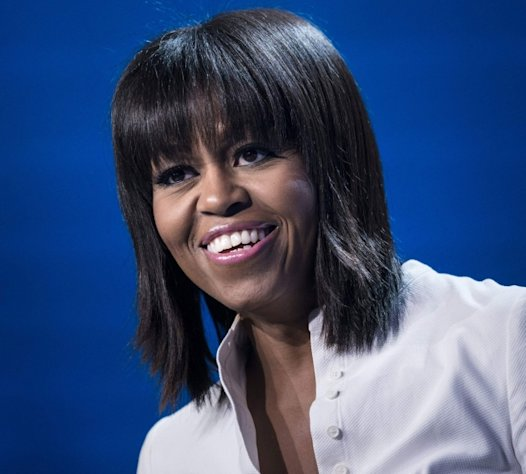 First Lady Michelle Obama smile while speaking during the Kids' Inaugural concert at the Washington Convention Center January 19, 2013 in Washington, DC -- Getty Images