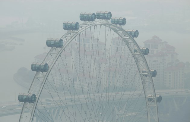 Singapore Flyer is pictured on a hazy day in Singapore