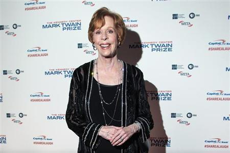 Comedian and actress Burnett arrives on the red carpet before being presented the Mark Twain Prize for American Humor in Washington
