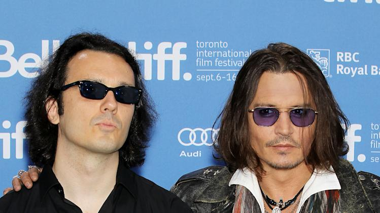 "This image released by Starpix shows Damien Echols, one of the West Memphis Three, left, and actor Johnny Depp at a press conference for the film ""West of Memphis"" at the 2012 Toronto International Film Festival in Toronto on Saturday, Sept. 8, 2012. (AP Photo/Starpix, Marion Curtis)"