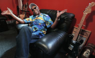 "In this Aug. 3, 2012 photo, blues legend Buddy Guy speaks about his new book, ""When I left Home"" in the office of his blues club Buddy Guy's Legends in Chicago's South Loop.. (AP Photo/M. Spencer Green)"
