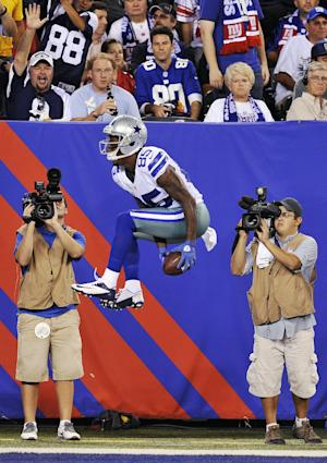 Fans watch as Dallas Cowboys wide receiver Kevin Ogletree celebrates scoring a touchdown during the second half of an NFL football game against the New York Giants, Wednesday, Sept. 5, 2012, in East Rutherford, N.J. (AP Photo/Bill Kostroun)