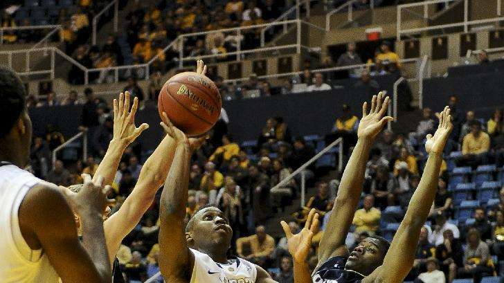 Virginia s juwan staten center looks to shoot while mount st mary