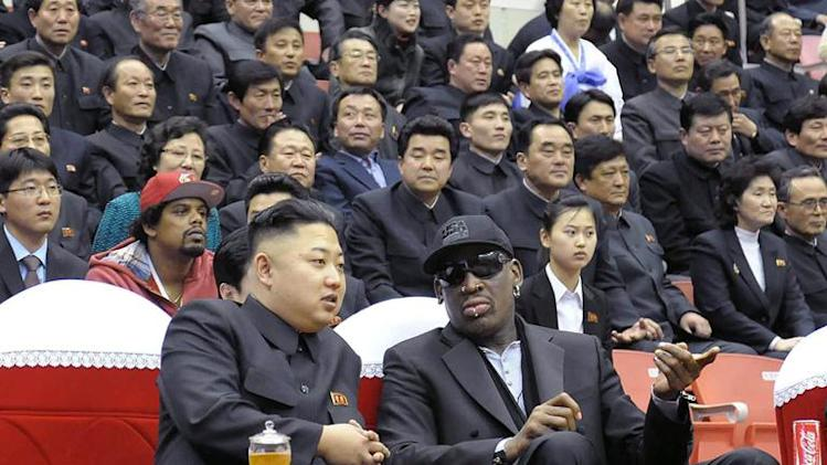 North Korean leader Kim Jong-Un and former NBA star Dennis Rodman chat at a basketball game in Pyongyang, on February 28, 2013
