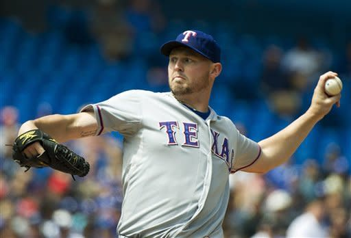 Young helps Rangers rout Blue Jays 11-2