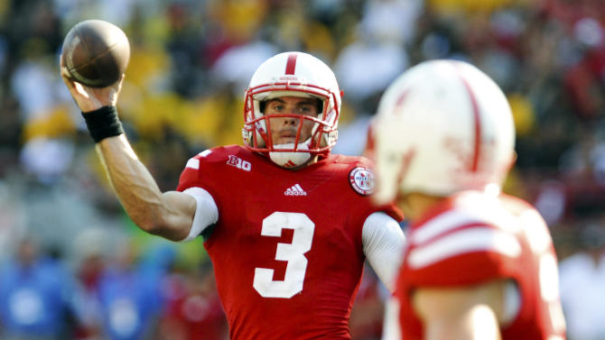 Nebraska quarterback Taylor Martinez (3) throws a pass to C.J. Zimmerer (31) during their NCAA college football game against Southern Mississippi, Saturday, Sept. 1, 2012, in Lincoln, Neb. (AP Photo/Dave Weaver)