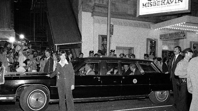 """FILE - In this Aug. 8, 1978 file photo, a female Secret Service agent leads the presidential limousine carrying President Jimmy Carter and his party from the Longacre Theater in New York after he saw the Broadway show, """"Ain't Misbehavin."""" The Secret Service has been tarnished by a prostitution scandal that erupted April 13, 2012 in Colombia involving 12 Secret Service agents, officers and supervisors and 12 more enlisted military personnel ahead of President Barack Obama's visit there for the Summit of the Americas. (AP Photo/Allan Jacobson)"""