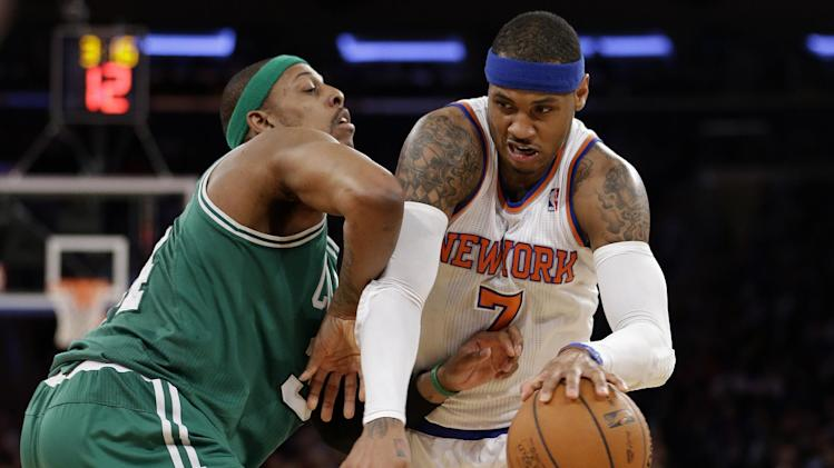 New York Knicks forward Carmelo Anthony (7) drives to the basket against Boston Celtics forward Paul Pierce (34) in the first half of Game 2 of their first-round NBA basketball playoff series in New York, Tuesday, April 23, 2013. (AP Photo/Kathy Willens)
