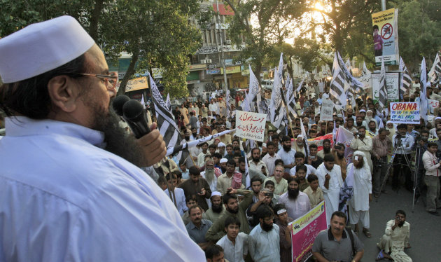 K.M. Chaudary - Hafiz Saeed, leader of Pakistani religious group Jamaat-ud-Dawa, left, delivers a speech during a protest against a film insulting the Prophet Muhammad, in Lahore, Pakistan,