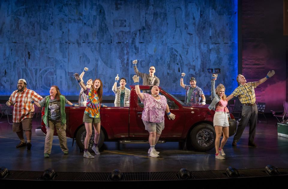 "This theater image released by The Hartman Group shows the cast during a performance of ""Hands on a Hard Body,""  at the Brooks Atkinson Theater in New York and featuring songs co-written by Phish frontman Trey Anastasio. (AP Photo/The Hartman Group, Chad Batka)"