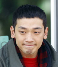 South Korean pop singer Rain is close to tears after meeting with his fans before he enters the army to serve in front of an army training center in Uijeongbu, north of of Seoul, South Korea, Tuesday, Oct. 11, 2011. (AP Photo/ Lee Jin-man)