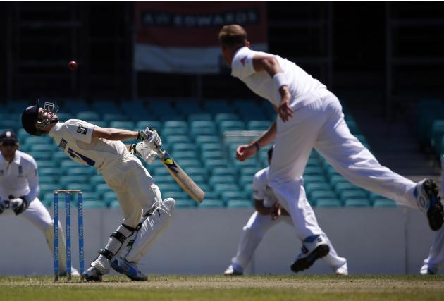 England's Broad bowls a bouncer at Cricket Australia Invitational XI player Kurtis Patterson during their warm-up match at the Sydney Cricket Ground