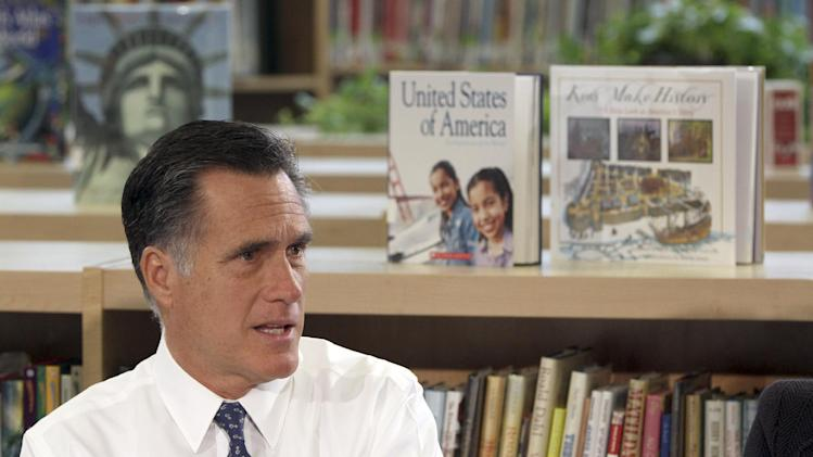 Republican presidential candidate, former Massachusetts Gov. Mitt Romney participates in a round table discussion at the Universal Bluford Charter School, Thursday, May 24, 2012, in Philadelphia.  (AP Photo/Mary Altaffer)