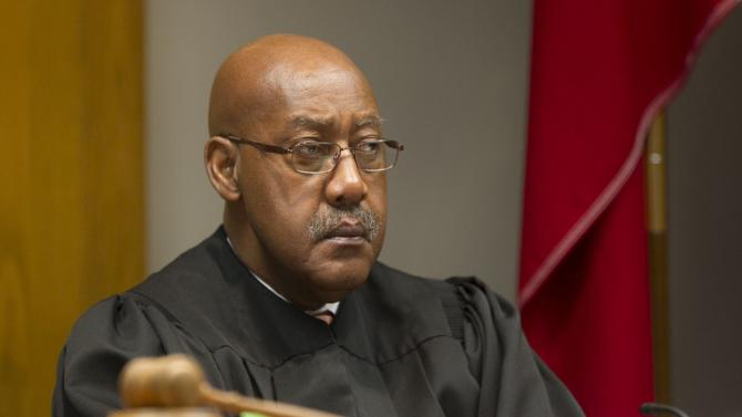 Judge Louis Sturns listens during the court of inquiry for Ken Anderson at the Williamson County Courthouse in Georgetown on Thursday, Feb. 7, 2013. An attorney who defended Michael Morton, who served nearly 25 years in prison for a wrongful murder conviction, is testifying in a special case to determine if prosecutorial misconduct led to the verdict. (AP Photo/Austin American-Statesman, Jay Janner, Pool)