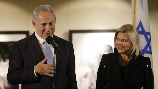 "CORRECTS DAY AND DATE - Israeli Prime Minister Benjamin Netanyahu, accompanied by his wife Sara, right, speaks before the screening of the television documentary ""Israel: The Royal Tour"" at Paramount Studios on Tuesday, March 4, 2014, in Los Angeles. Netanyahu flew Tuesday from Washington, D.C., to California, trading a focus on the geopolitics of the Middle East for a Hollywood screening and visits with Silicon Valley tech entrepreneurs. (AP Photo/Jae C. Hong)"