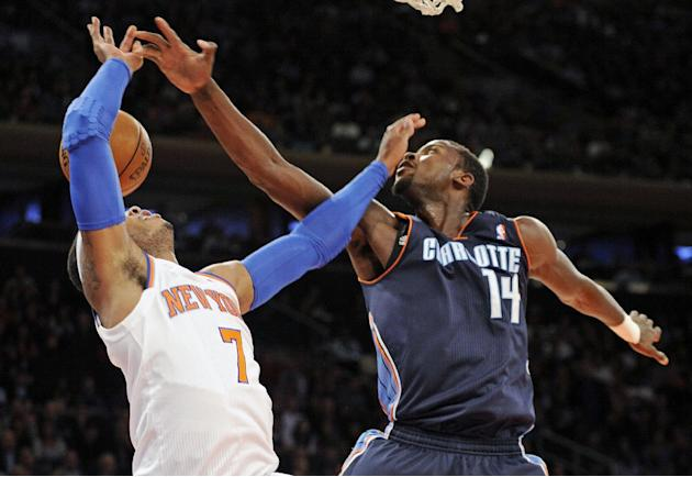 Charlotte Bobcats' Michael Kidd-Gilchrist, right, slaps the ball from New York Knicks' Carmelo Anthony during the first quarter of an NBA basketball game Tuesday, Nov. 5, 2013, at Madison Square Garde