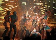 Ke$ha performs at the 40th Annual American Music Awards on Sunday, Nov. 18, 2012, in Los Angeles. (Photo by Matt Sayles/Invision/AP)