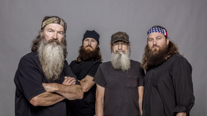 """This 2012 photo released by A&E shows, from left, Phil Robertson, Jase Robertson, Si Robertson and Willie Robertson from the A&E series, """"Duck Dynasty."""" The A&E channel says """"Duck Dynasty"""" patriarch Phil Robertson is off the show indefinitely after condemning gays as sinners in a magazine interview. In a statement Wednesday, Dec. 18, 2013, A&E said it was extremely disappointed to read Robertson's comments in GQ magazine. (AP Photo/A&E, Zach Dilgard)"""
